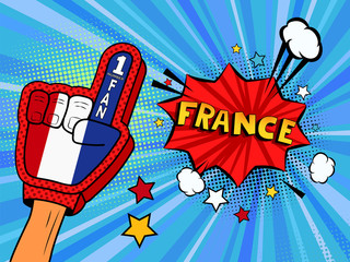 Male hand in the country flag glove of a sports fan raised up celebrating win and France speech bubble with stars and clouds. Colorful illustration in retro comic style