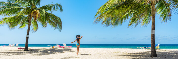 Wall Mural - Caribbean tropical beach vacation woman dancing of happiness under the sun. Summer holidays travel getaway banner panorama.