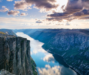 Majestic view of the Lysefjorden, with mountains on the sunset. The mountain Kjerag in Forsand municipality in Rogaland county, Norway.