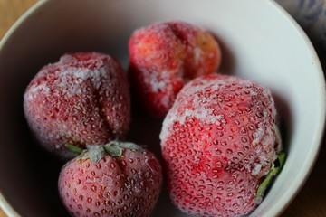 Frozen strawberries on a plate.
