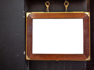 Mock up template of restaurant menu displayed in a old wooden box hanging on wall.
