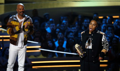 Actor Waithe accepts the Trailblazer Award, as Common watches, at the 2018 MTV Movie & TV Awards at Barker Hangar in Santa Monica