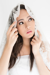 beauty or bride, behind a white veil