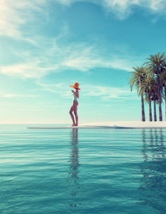 Tropical island - woman standing on tropical beach