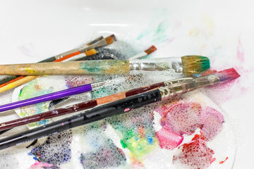cleaning and maintenance of artistic brushes. wash with paint brush
