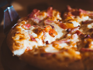 Close up of small size of ham and cheese pizza.