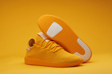 Sport shoes theme in yellow color