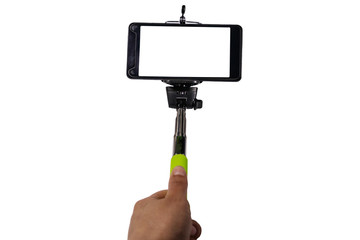 Human hand holding monopod for selfie with smartphone isolated on white background