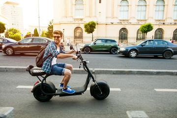 young man riding an electric vehicle
