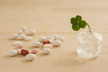 Pills with four leaf clover