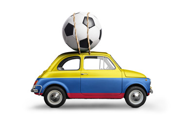 Colombia flag on car delivering soccer or football ball isolated on white background