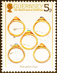 Twelve days of Christmas - 5 gold rings on postage stamp of Guernsey