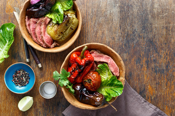 Grilled steak with grilled vegetables served in bread plate