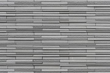Modern grey stone wall pattern and background