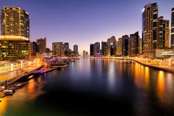 Dubai Marina at beautiful blue hour cityscape purple sky, United Arab Emirates