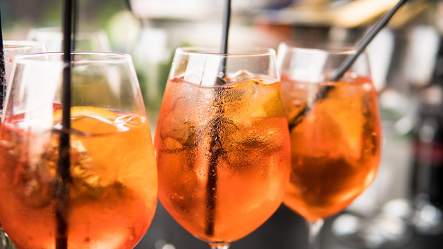 .summer citrus cold alcohol drink Aperol Spritz close-up