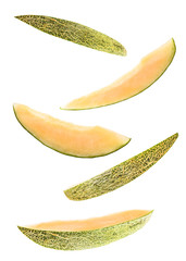 set of five flying melon slices isolated on white background. cut melon fruit in pieces isolated on white background. Levity fruit floating in the air