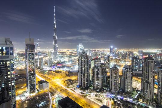 World longest building Burj Khalifa with Dubai Downtown Towers Top View at night
