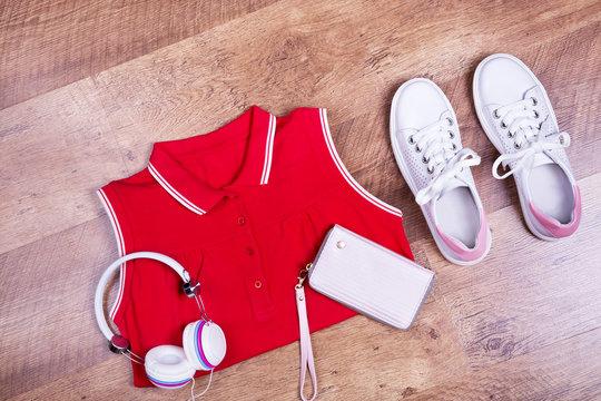 Red dress, sneakers, headphones, wallet