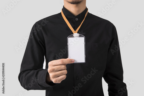 employee hand showing blank id card badge holder for mockup template