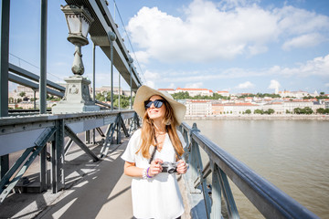 Young woman tourist walking on the famous Chain bridge traveling in Budapest city, Hungary