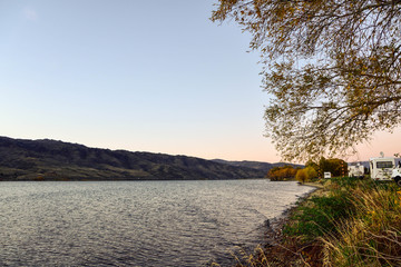 Cromwell , NEW ZEALAND - May 3, 2016: Lowburn Harbour  camping site in sunrise time