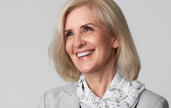 Portrait of smiling business woman looking away