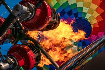 Poster Ballon Hot air balloon, bright burning fire flame from gas burner equipment, close up from inside