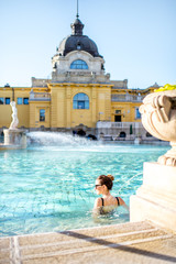 Aluminium Prints Budapest Woman relaxing with water jet massage at the famous Szechenyi thermal bathes in Budapest, Hungary