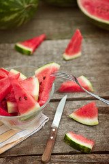 Fork on watermelon slice in glass bowl