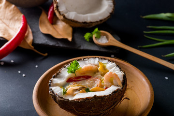 coconut soup in a half of coconut. Thai cuisine