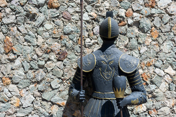 Knight in Armor with Spear along Stone Wall