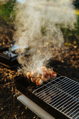Smoking bacon skewers on griddle