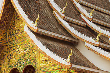 Foto op Canvas Temple Facade and roof decoration of the Haw Pha Bang Buddhist temple at the Royal Palace Museum in Luang Prabang, Laos.