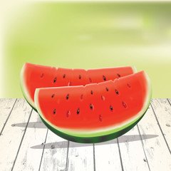 Watermelon slices on the wooden table