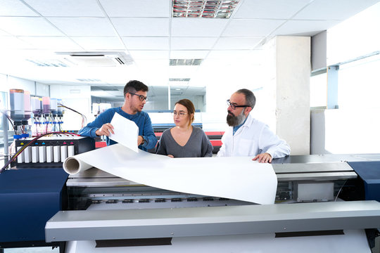 Printing team at industry plotter printer