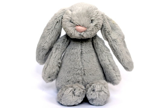 A grey fluffy soft toy rabbit for baby / toddler / child