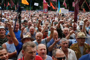 Members of different veteran organizations and miners attend a rally demanding to keep their social benefits, pensions and for full payment of their wages, in a front of the Ukrainian parliament in Kiev