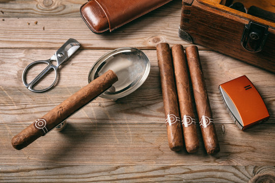 Cuban cigars on wooden background, top view