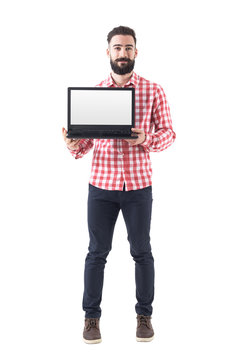 Proud successful smart casual bearded man showing blank laptop screen. Full length isolated on white background.