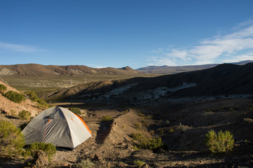in Bolivian highland with tent