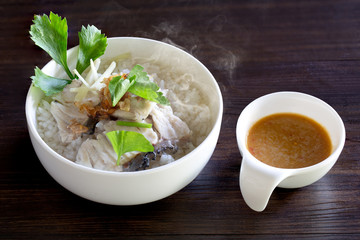 Boiled rice with sea bass in white bowl delicious food for thai breakfast..