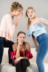 Woman being bullied by two females