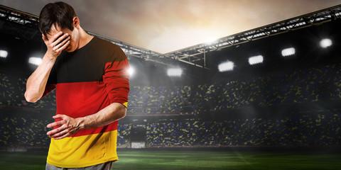 Germany national team. Sad soccer or football player on stadium