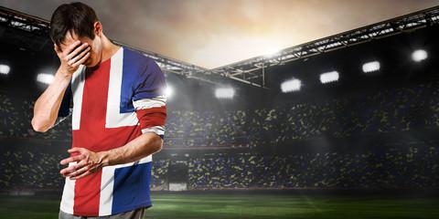 Iceland national team. Sad soccer or football player on stadium