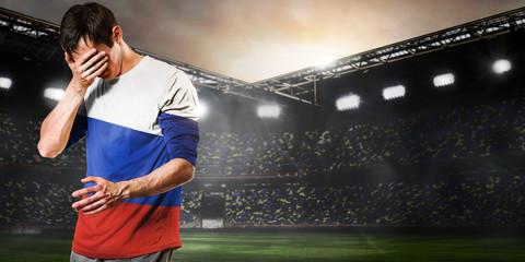 Russia national team. Sad soccer or football player on stadium