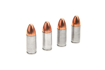 cartridges for a pistol isolated on white
