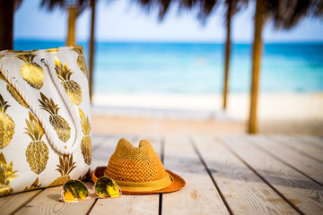 Summer Vacation - Yellow Glasses, Beach Bag and Hat near the Sea