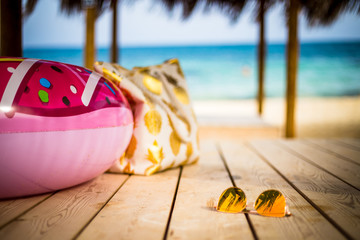 Summer Vacation - Yellow Glasses, Beach Bag and Hat near the Sea Inflatable Ring near the Sea