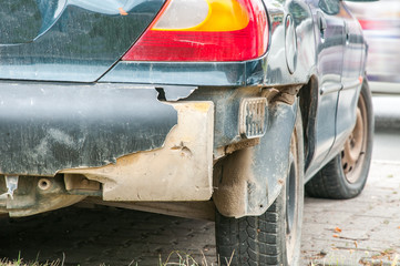 Broken and damaged rear bumper on the car in crash accident or collision in the traffic